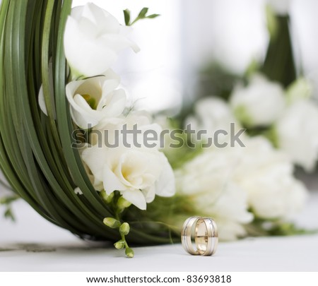 wedding bouquet and rings - stock photo