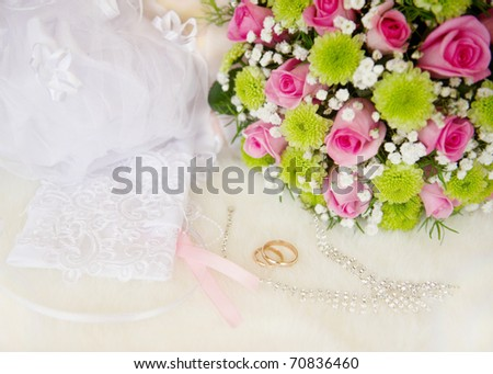 Wedding bouquet and rings, soft focus.