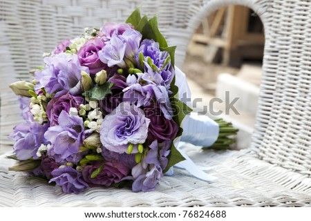 wedding bouquet at chair - stock photo