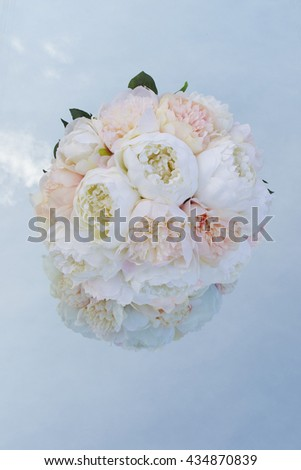 Wedding Bouquet blue sky background reflecting on mirror - stock photo