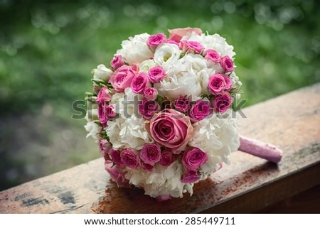 Wedding bouquet composed of small buds beautiful roses - stock photo