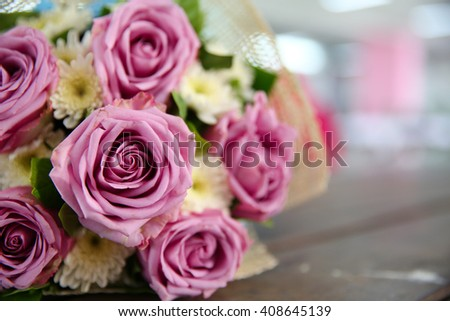 Wedding Bouquet,  Flower bouquet of roses on wooden background, selective focus, Shallow depth of field - stock photo