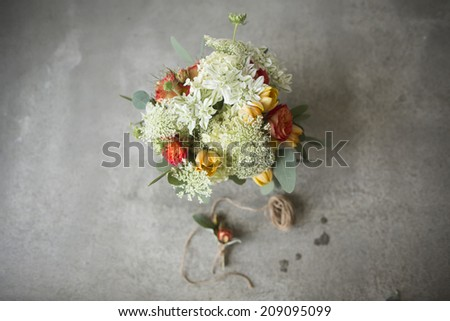 Wedding bouquet in a rustic style with boutonniere