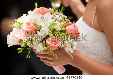 Wedding bouquet in bridal hand - stock photo