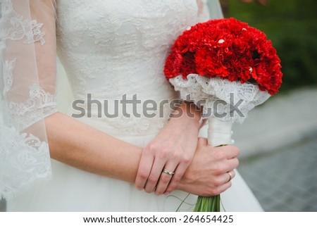 Wedding bouquet in bride's hand - stock photo