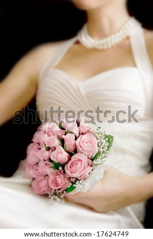 wedding bouquet in bride's hands, focus on flowers - stock photo