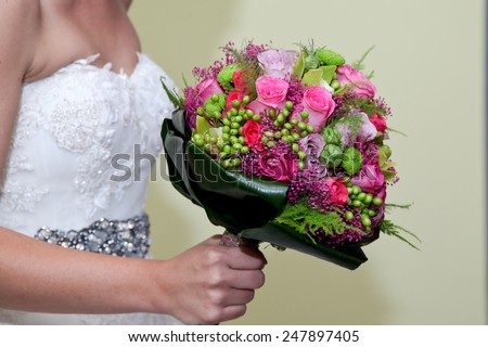 Wedding bouquet in brides hand - stock photo
