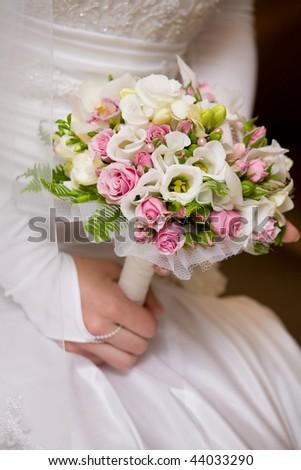 wedding bouquet in brides hand - stock photo
