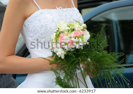 Wedding bouquet in brides hands