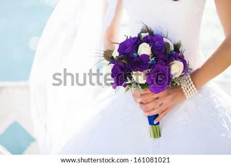 wedding bouquet in hands of the bride - stock photo