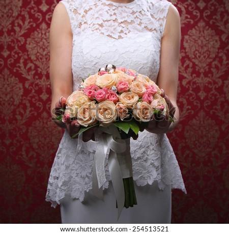Wedding bouquet in hands of the bride. - stock photo