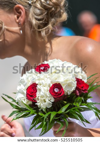 Wedding bouquet in hands of the bride at the mayor