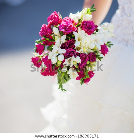 wedding bouquet in the bride's hand - stock photo