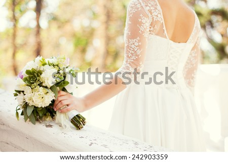 wedding bouquet in the hands - stock photo