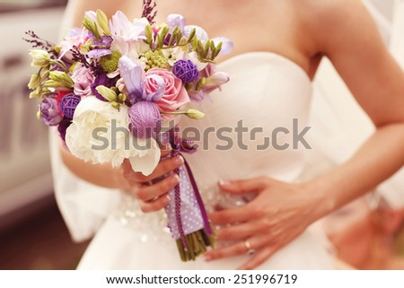 Wedding bouquet in the hands of a bride - stock photo