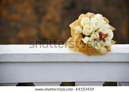 Wedding bouquet lying on the balcony - stock photo