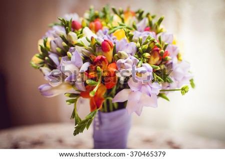 Wedding bouquet made of colorful flowers - stock photo