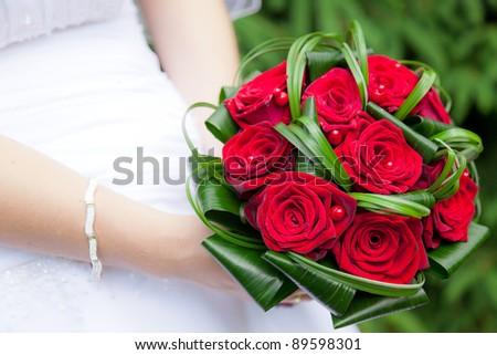 Wedding bouquet of bride's hands - stock photo