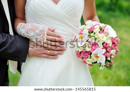 Wedding bouquet of flowers held by a bride
