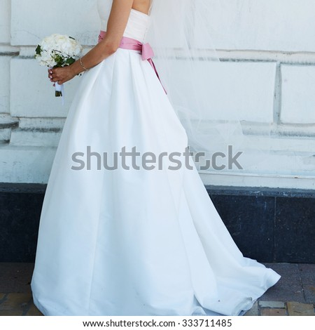 Wedding bouquet of flowers in bride hands