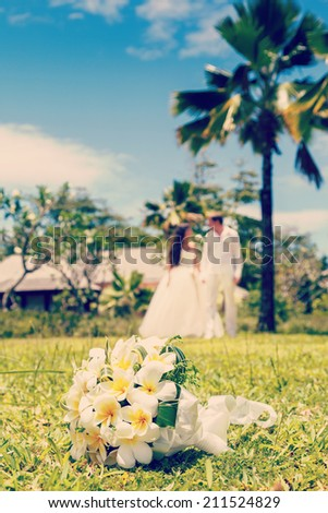 wedding bouquet of frangipani, bride and groom, newlyweds - stock photo