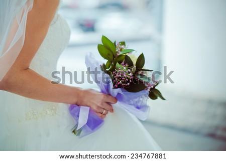Wedding bouquet of hydrangea in hands of bride - stock photo