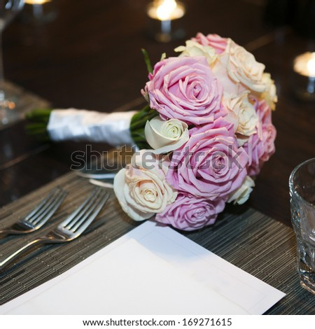 wedding bouquet of pink and white roses on the table - stock photo
