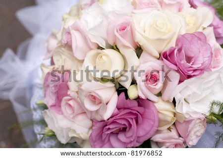 Wedding bouquet of pink roses, soft focus.