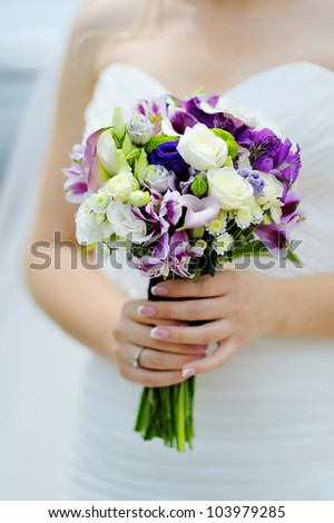 wedding bouquet of purple and white flowers - stock photo