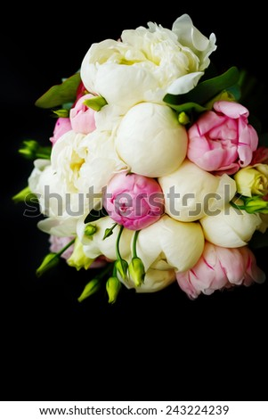 Wedding bouquet of ranunculus and peony flowers on black background. Stylized oil painting. Space for text. Selective focus. - stock photo