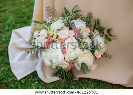 Wedding bouquet of roses on green grass