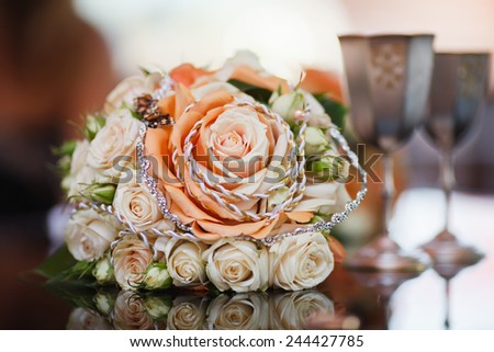 Wedding bouquet of roses on the reflection surface