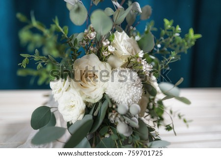 wedding bouquet of white roses, chrysanthemums, eucalyptus branches, brunia