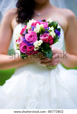 Wedding bouquet on a background of a dress - stock photo