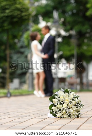 Wedding bouquet. On a background the newly-married couple. - stock photo