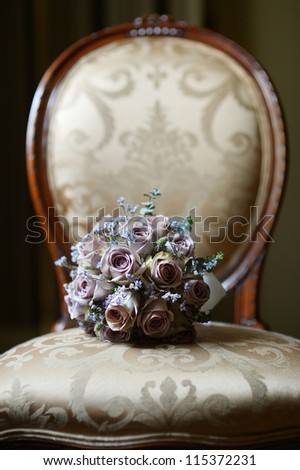 Wedding bouquet on a vintage chair