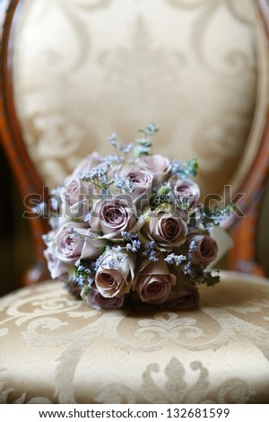 Wedding bouquet on a vintage chair - stock photo