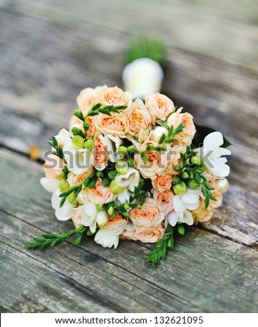 Wedding bouquet on a wood surface - stock photo