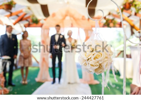 Wedding bouquet on the background with ceremony of newlyweds - stock photo