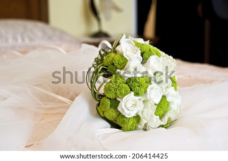 Wedding bouquet on the bed - stock photo