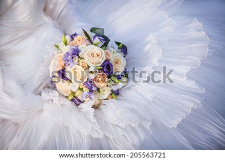 Wedding bouquet on the dress - stock photo