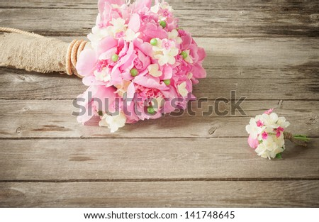 wedding bouquet on wooden background - stock photo