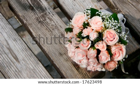 wedding bouquet on wooden bench - stock photo