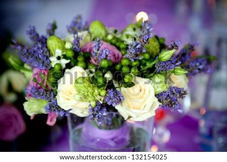 wedding bouquet on wooden table - stock photo