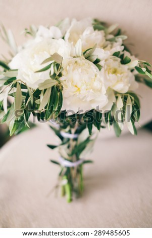 wedding bouquet white peony on armchair pastel background in fine art style