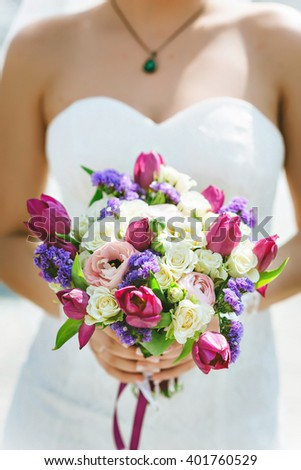 Wedding bouquet, white, pink, purple flowers. In the hands of the bride - stock photo