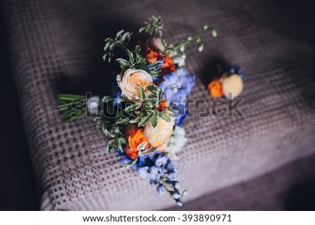 Wedding Bouquet with boutonniere on brown cloth bad with tape - stock photo