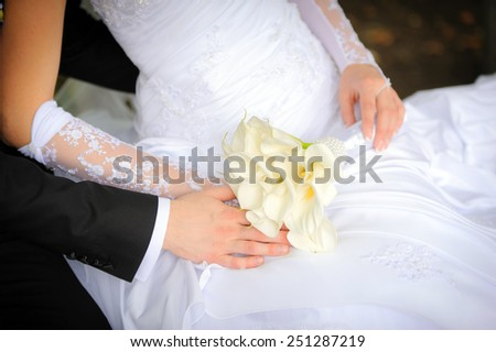 wedding bouquet with bride and groom - stock photo