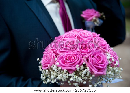 wedding bouquet with groom - stock photo
