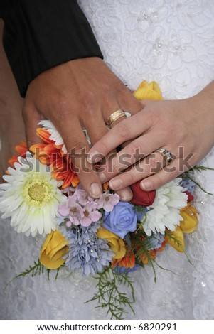 wedding bouquet with hands - stock photo